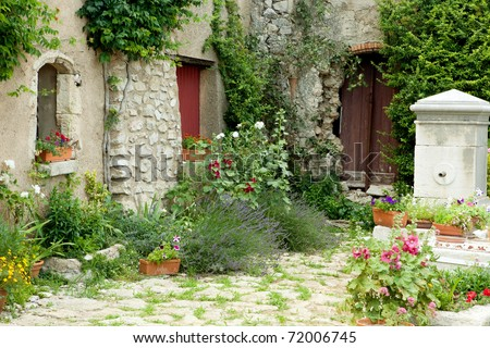 View on a typical rustic Provence garden in France - stock photo