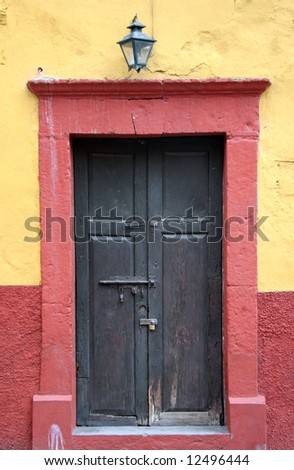 View on a typical urban scene with colorful entrance and old rusted city light. Guadalajara. Mexico - stock photo