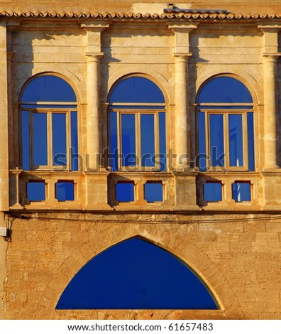 view on an old and modern window in the old town of Palma de Majorca - stock photo