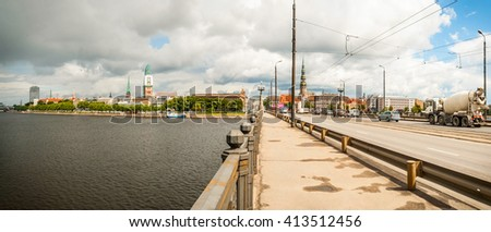 View on bridge over river against of cityscape of Riga,Latvia - stock photo