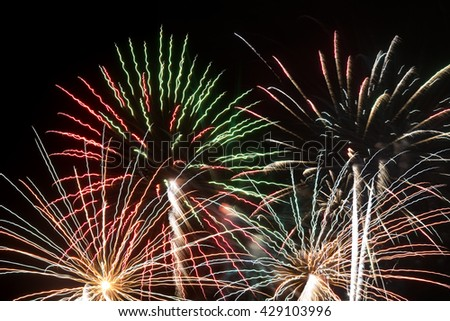 View on bright fireworks in dark sky - stock photo