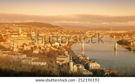 View on Budapest from Gellert Hill, Hungary. Houses, river Danube in the background of mountains and clear blue sky. Toned. - stock photo