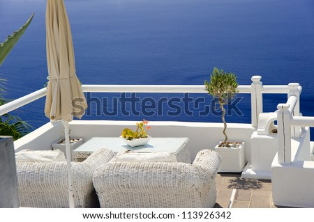 View on caldera and sea from balcony at Santorini island, Greece - stock photo