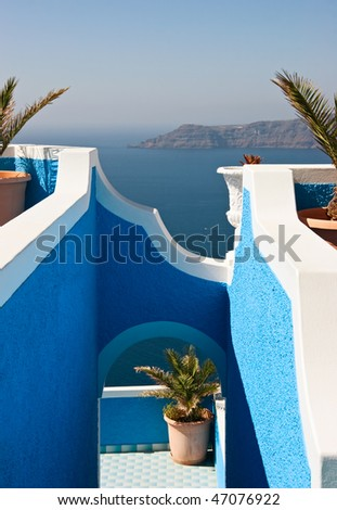 View on caldera and sea through blue arch, Santorini, Greece. - stock photo