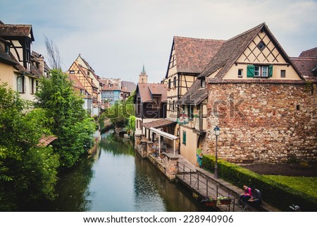 View on Colmar, Petit Venice, water canal and traditional colorful houses. Alsace, France.