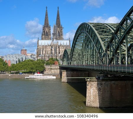 View on Cologne Cathedral and Hohenzollern Bridge over the Rhine river, Germany - stock photo