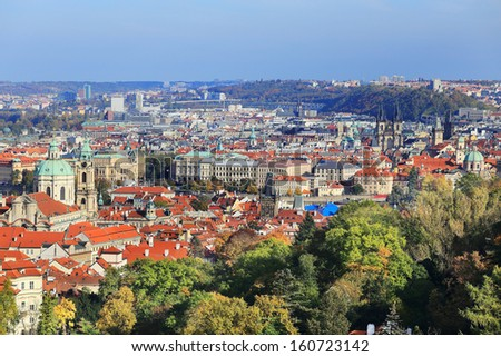 View on colorful autumn Prague City with its Towers and historical Buildings, Czech Republic