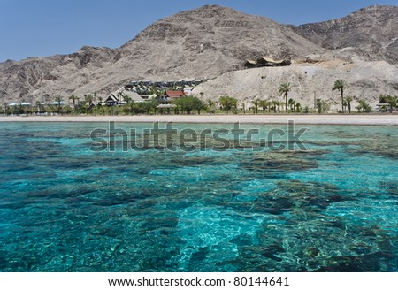 View on coral reef and resort hotels at southern beach of Eilat city – famous recreation spot in Israel - stock photo