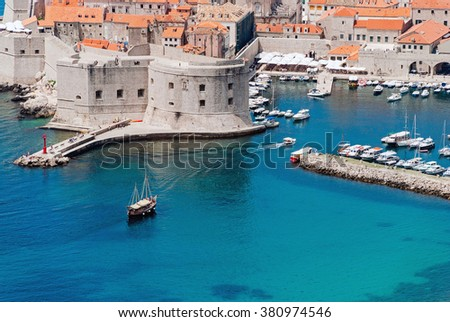 View on Dubrovnik, Croatia from the mountains with ships and yachts in harbor - stock photo