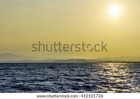 View on Fuji mountain through evening haze over water - stock photo