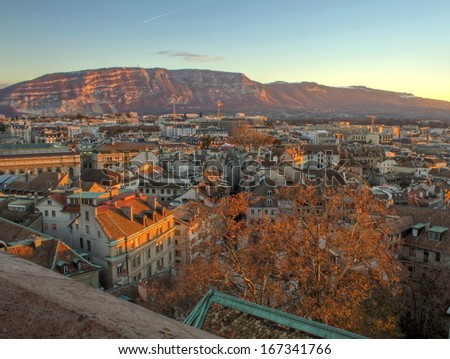 View on Geneva city and Saleva mountain by sunset from Saint-Pierre cathedral, Switzerland (HDR) - stock photo