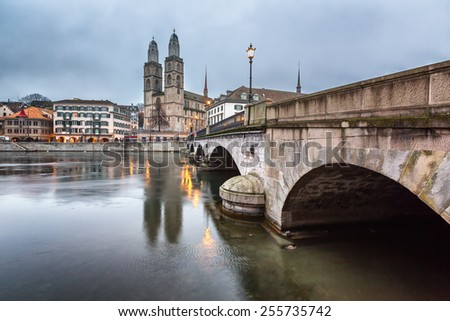 View on Grossmunster Church and Zurich Downtown in the Evening, Switzerland - stock photo