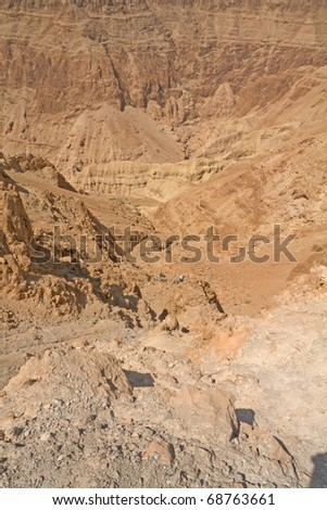 View on Judean desert mountain with remains of crashed cars on the bottom of abyss not far from Metzoke Dragot village. - stock photo