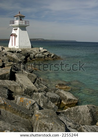 View on lighthouse, northern Ontario, vertical. - stock photo