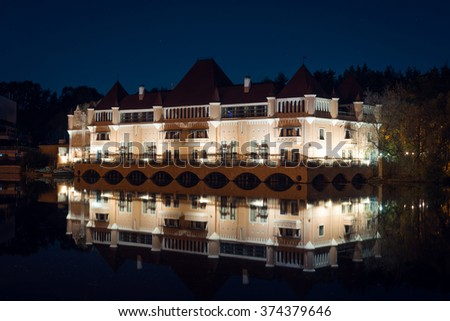 View on living palace or castle on pond at territory of VDNH in the night - stock photo