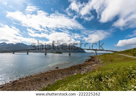 View on lofoten landscape with bridge and blue sky.