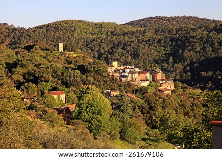View on medieval village with forest hills landscape, Provence, France. Sunrise light - stock photo