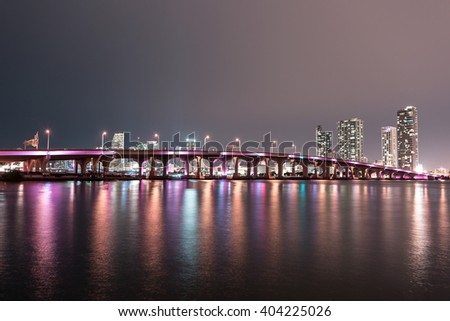 View on Miami Downtown and MacArthur Causeway at night time with a view on a bay, USA