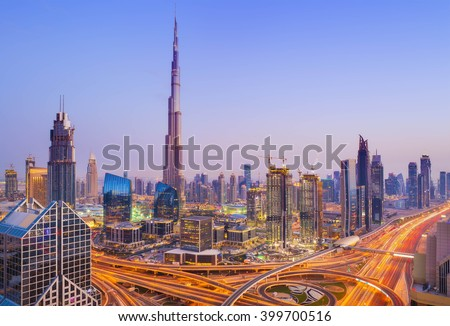 View on modern skyscrapers and busy evening highways in luxury Dubai city,Dubai,United Arab Emirates - stock photo