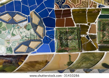 view on mosaic wall from ceramic broken tile, part of Tiled Bench in Parc Guell, one of Barcelona's biggest tourist attractions - stock photo