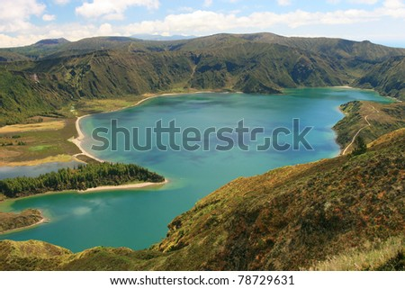 view on mountains with flowers - stock photo