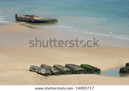 View on Mulberry harbour at Arromanches, Normandy, France, with the remains of the artificial harbour, used on D-Day in World War II - stock photo