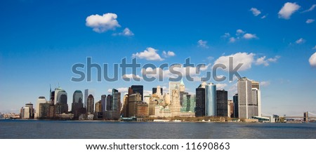 View on New York under blue skies from Hudson River - stock photo