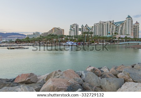 View on northern beach of the Red Sea in Eilat â?? famous resort and recreation town in Israel   - stock photo