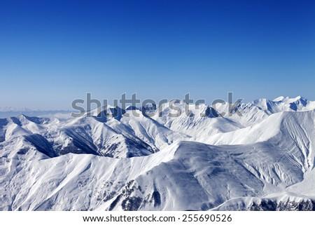 View on off-piste slope at nice sun day. Caucasus Mountains, Georgia. Ski resort Gudauri. - stock photo