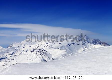 View on off-piste slope. Caucasus Mountains, Georgia, ski resort Gudauri. - stock photo