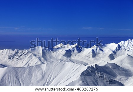 View on off-piste slopes and blue sky at nice sunny day. Caucasus Mountains, Georgia, ski resort Gudauri.