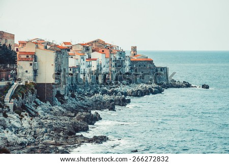 View on old houses in Cefalu. Sicily island, Italy. Toned image - stock photo