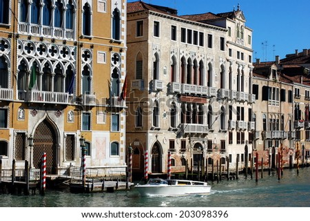 View on Palazzo Cavalli-Franchetti, boats and buildings from the Grand Canal in Venice, Italy.  - stock photo