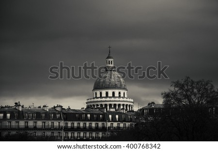 View on Pantheon building from Luxembourg gardens in cloudy day. Toned evening photo. Black and white. - stock photo