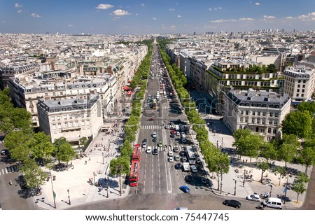 View on Paris from Arc de Triomphe. Avenue Champs elysees in front. - stock photo