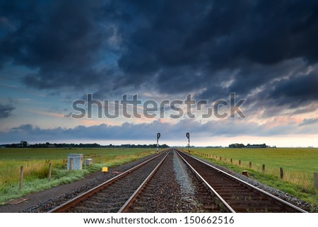 view on railway road in early morning sunrise, Groningen, Netherlands - stock photo