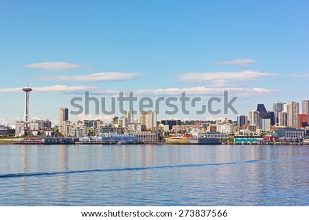 View on Seattle downtown from the waters of Puget Sound. City skyscrapers and piers along Seattle city waterfront before sunset. - stock photo