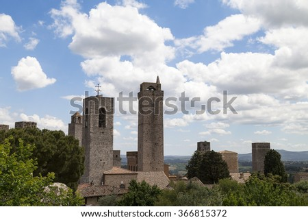 view on some of famous towers in San Gimignano in Toscany in Italy on blue sky background