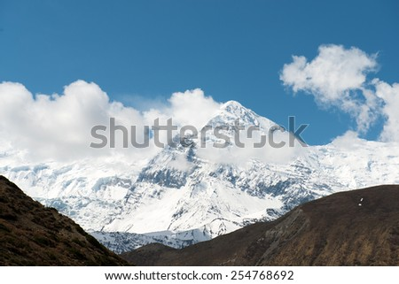 View on the Annapurna massif on a Annapurna Circuit - most popular turists trek in Himalayan mountain massive in Nepal. - stock photo