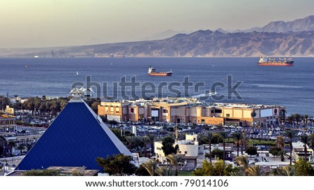View on the Aqaba gulf and main shopping center in Eilat, Israel - stock photo