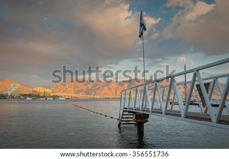 View on the Aqaba gulf from the central beach of Eilat - famous resort and recreational city in Israel - stock photo