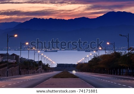 View on the Aqaba gulf 30 min before sunset, local street of Eilat, Israel - stock photo