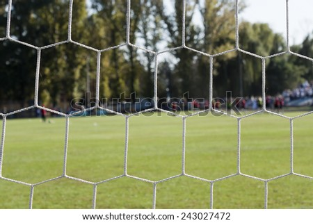 View on the football field over the net gate - stock photo