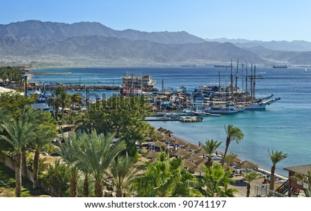 View on the gulf of Aqaba and sand beach of Eilat - the main resort city of Israel - stock photo