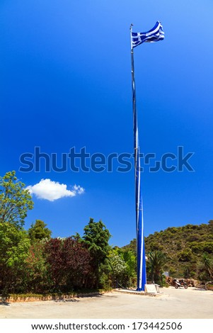 View on the mast of the Biggest Greek flag in the world  at Keri on the island Zakynthos, Greece. With strong winds a smaller flag is raised - stock photo