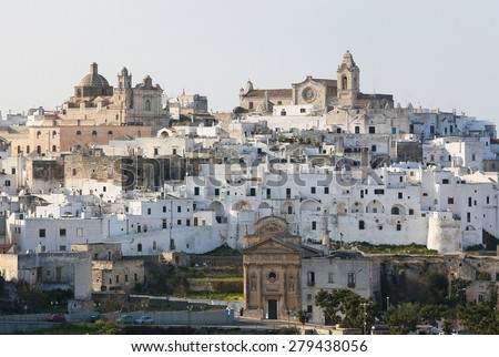 View on the medieval old town of Ostuni in Puglia, South Italy.The center of Ostuni is known as the White Town or La Citta Bianca and a famous site in Italy. - stock photo
