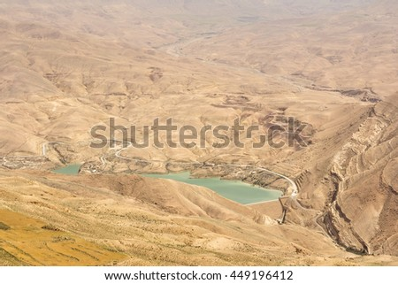 View on the Mujib Dam located in Wadi Mujib, between the cities of Madaba and Kerak, in the Madaba Governorate of Jordan. - stock photo