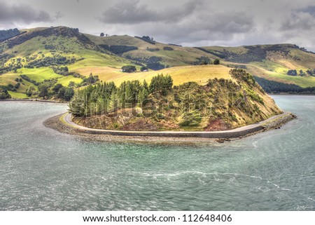 View on the New Zealand hills from Otago Harbour Bay, Port Chalmers, South Island. - stock photo