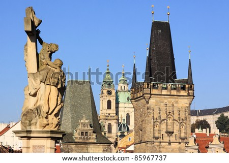 View on the Prague St. Nicholas' Cathedral with Bridge Tower of the Charles Bridge, Czech Republic