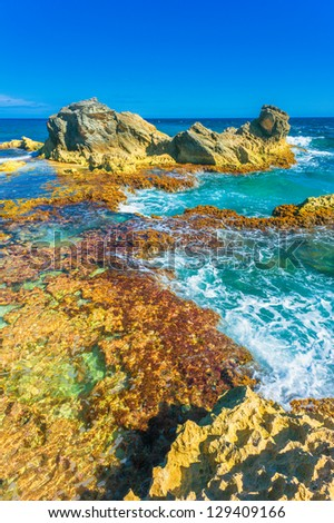 View on the rocks on southern tip (Punta Sur) of Isla Mujeres, Mexico - stock photo